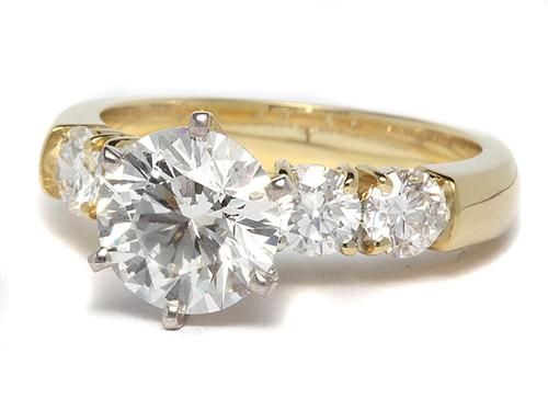 Gold  Rings With Side Stones